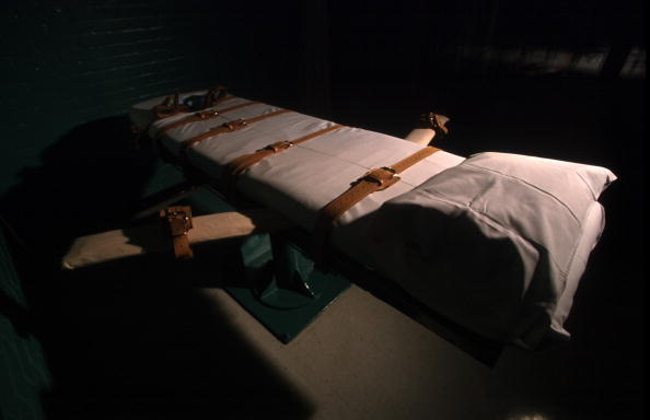 """The state of Oklahoma attempted a """"double execution"""" with a new """"drug cocktail."""" The procedure went horribly wrong and Clayton Lockett ultimately died of a massive heart attack (Photo Credit: Mike Simons/Getty Images)."""
