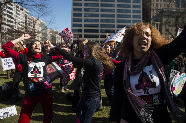 Supporters of the Violence Against Women Act dance in Farragut Square as part of the V-DAY's One Billion Rising dance party and rally to stop violence against women (Photo Credit: Bill Clark/CQ Roll Call).