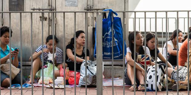 There are more than 300,000 migrant domestic workers in Hong Kong, with about half from Indonesia (Photo Credit: Amnesty International).