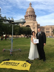 The University of Texas-Austin Amnesty chapter was in the middle of organizing the Die-In when this lovely couple came up. At first we thought they were going to ask us to move so they could take wedding pictures but instead, they wanted to be part of our photo action.