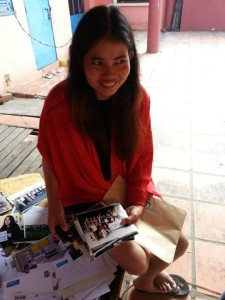 Yorm Bopha with messages and photos she received from Amnesty International activists and supporters around the world as part of the Letter Writing Marathon 2013 (Photo Credit: Amnesty International).
