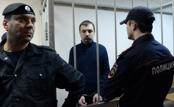 Mikhail Kosenko stands in a defendant cage in a court in Moscow (Photo Credit: Vasily Maximov/AFP/Getty Images).