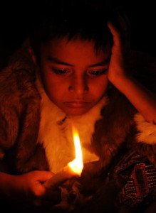 A child holds a candle during a vigil on the 25th anniversary of the world's worst industrial accident in Bhopal (Photo Credit: Indranil Mukherjee/AFP/Getty Images).