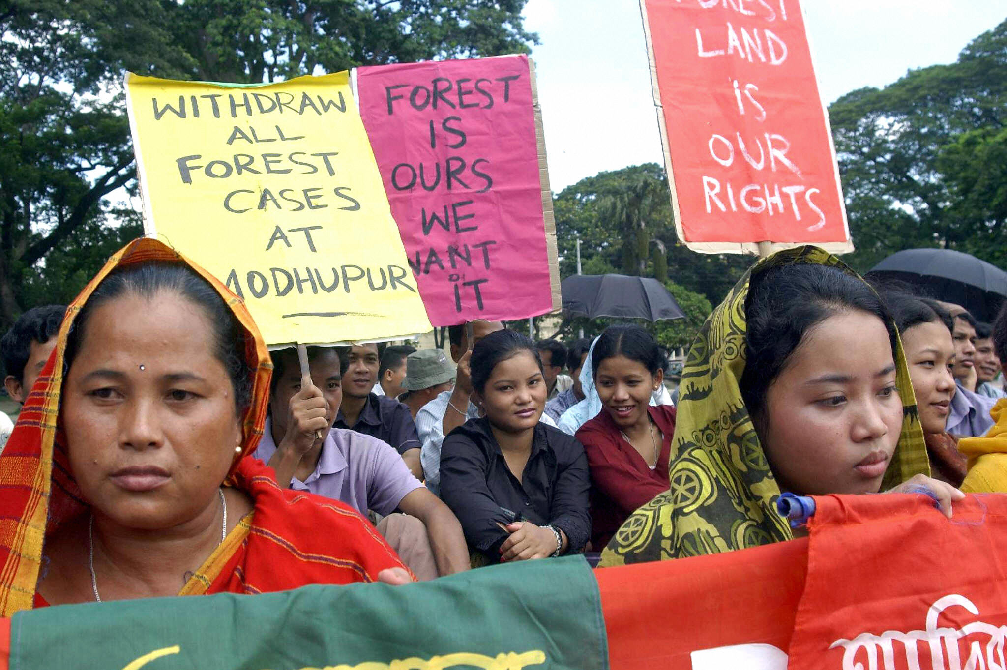 Indigenous Bangladeshi women during a demonstration demanding an end to encroaching development on their lands, still asking for the rights Kalpana Chakma fought for before her disappearance (Photo Credit: Shawkat Khan/AFP/Getty Images).