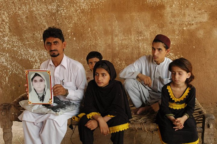 Mamana Bibi's family. Mamana Bibi was a 68-year-old woman picking okra with her grandchildren when she was killed by a drone strike.