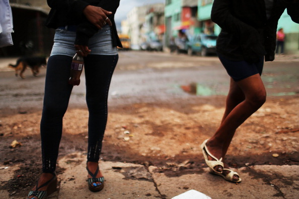 Sex workers wait for customers in Honduras. Honduras now has the highest per capita murder rate in the world and its capital city, Tegucigalpa, is plagued by violence, poverty, homelessness and sexual assaults (Photo Credit: Spencer Platt/Getty Images).