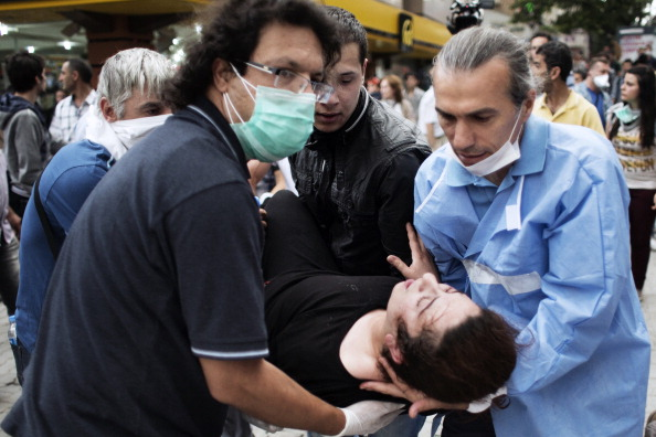 A bill passed by the Turkish parliament last week could give authorities new powers to prosecute doctors for giving unauthorized care (Photo Credit: Marco Longari/AFP/Getty Images).