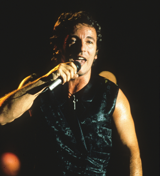 Bruce Springsteen performing at the Human Rights Now! tour. The series was a twenty-concert world tour held over a six-week period in 1988. The tour commemorated the 40th anniversary of the Universal Declaration of Human Rights (Photo Credit: Ken Regan/Neal Preston for Amnesty International).
