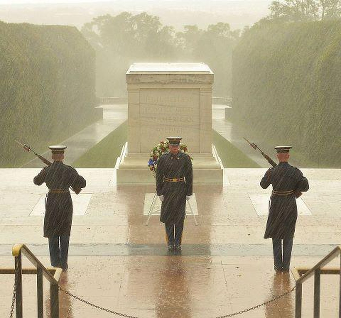 During Hurricane Sandy, NPR posted this image showing soldiers at Arlington National Cemetery guarding the tomb of the unknown soldiers. Though the outlet reported it was taken during the storm, it was actually taken several months before (Photo Credit: NPR).