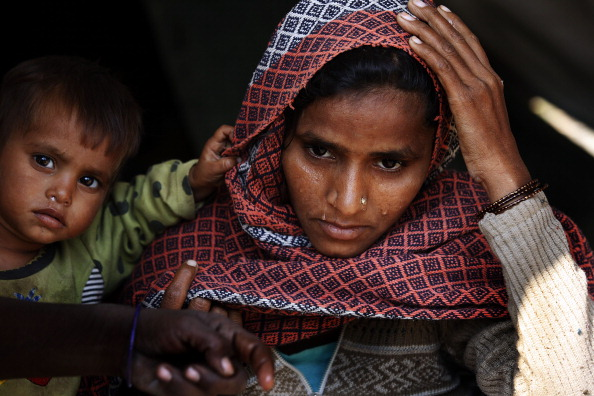 Dilshana Begum, 25, lost her five month old boy to cold at Malakpur camp in Shamli, India (Photo Credit: Raj k Raj/Hindustan Times via Getty Images).