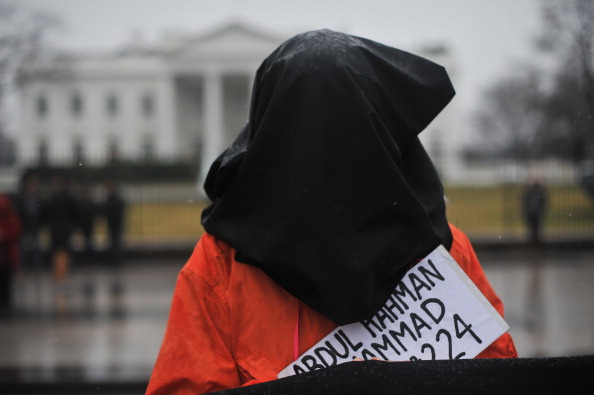 A protester calling for the closing of Guantanamo in front of the White House in Washington on January 11, 2014 to mark the 12th anniversary of the arrival of the first detainees. Today, January 22, 2014, marks the 5th anniversary after President Obama signed an executive order to close the facility (Photo Credit: Nicholas Kamm/AFP/Getty Images).