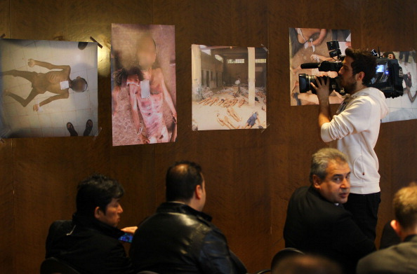 Syrian opponents hold a press conference about the newly published photos of Syria War Crime evidence in Montreux, Switzerland, on January 23, 2014 (Photo Credit: Evren Atalay/Anadolu Agency/Getty Images).