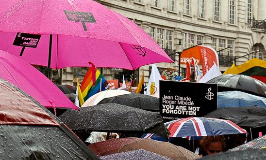 Showing solidarity with Roger Jean-Claude Mbede at a rainy London Pride in 2012 © I Uppal