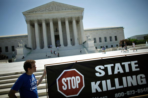 An activist fasts with other death penalty opponents in front of the U.S. Supreme Court in Washington, D.C. (Photo Credit: Chip Somodevilla/Getty Images).