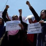 Afghan university students and independent civil society activists take part in a demonstration in support of passing the Elimination of Violence against Women law in front of Parliament in Kabul (Photo Credit: Shah Marai/AFP/Getty Images).