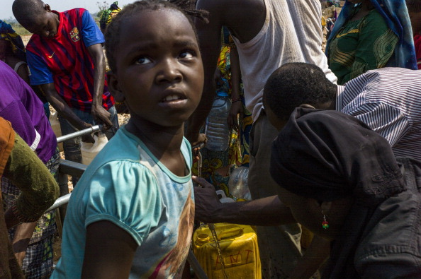 The Seleka coup plunged the country into chaos, unleashing a wave of Muslim-Christian violence that has left thousands dead. Hundreds of thousands of people have also been displaced by the brutal surge of killings, mutilations, rapes and looting (Photo Credit: Fred Dufour/AFP/Getty Images).