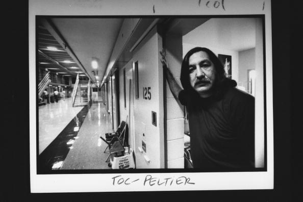 Leonard Peltier, a Chippewa-Lakota Indian serving a life sentence for the murder of 2 FBI agents, posing in the open doorway of his cell at Leavenworth Federal Penitentiary  (Photo Credit: Taro Yamasaki//Time Life Pictures/Getty Images).