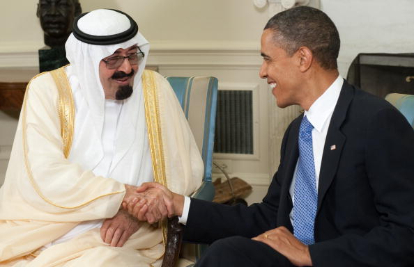 President Barack Obama shakes hands with King Abdullah bin Abdulaziz Al Saud of Saudi Arabia during meetings in the Oval Office at the White House on June 29, 2010 (Photo Credit: Saul Loeb/AFP/Getty Images).