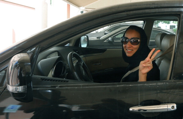 Saudi activist Manal Al Sharif, who now lives in Dubai, flashes the sign for victory in solidarity with Saudi women campaigning for women's right to drive in Saudi Arabia (Photo Credit: Marwan Naamani/AFP/Getty Images).