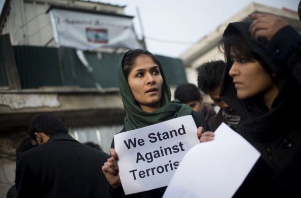 Afghan independent civil society activists pay tribute to the victims of Taliban suicide attack on a restaurant in Kabul (Photo Credit: Johannes Eisele/AFP/Getty Images).