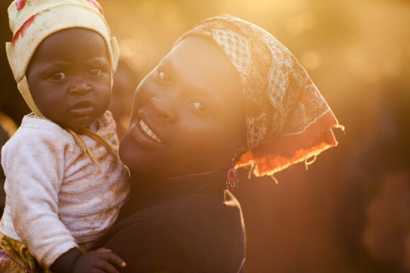 Portrait of a mother with her child in Chimoio, Mozambique (Photo Credit: Ute Grabowsky/Photothek via Getty Images).