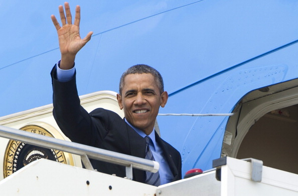 President Obama waves as he boards Air Force One prior to his departure for Saudi Arabia to meet with King Abdullah (Photo Credit: Saul Loeb/AFP/Getty Images).