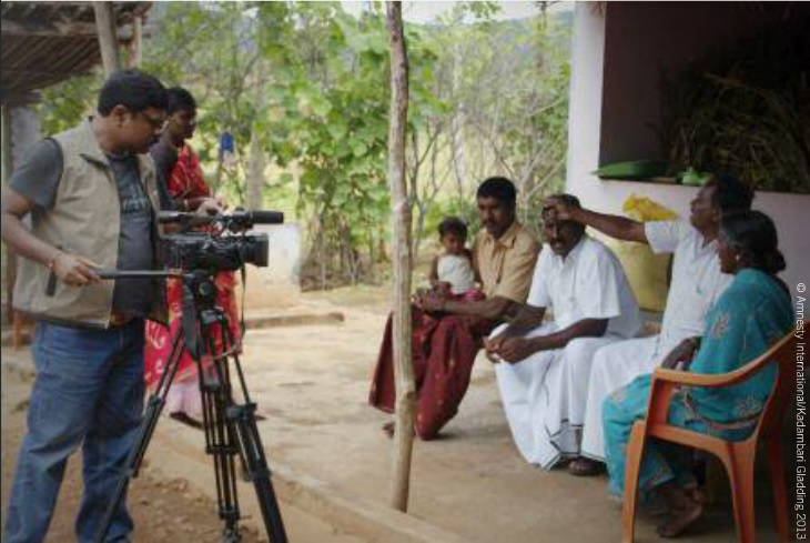 Amnesty staff in India speak to Gnanapragasam, one of the four men sentenced to death in 2002 in south India. All four had their sentences commuted to life on January 21, 2014 (Photo Credit: Amnesty International).