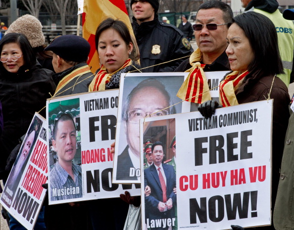 Vietnamese Americans protest on Pennsylvania Avenue, in front of the White House, demanding the release of political prisoners March 5, 2012, in Washington, D.C. Human rights lawyer Cu Huy Ha Vu was recently released (Photo Credit: Paul J. Richards/AFP/Getty Images).