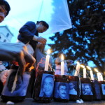 Honduran journalists take part in a vigil in memory of over 20 journalists killed in Honduras in Tegucigalpa, Honduras (Photo Credit: Orlando Sierra/AFP/GettyImages).