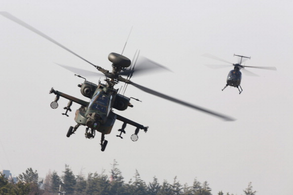 In 2013, Amnesty International documented the use of attack helicopters by Egyptian security forces for surveillance against crowds and protesters. Now, the Obama administration is selling 10 Apache military helicopters to the country (Photo Credit: Ken Ishii/Getty Images).