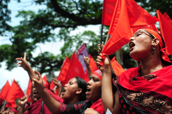 Tens of thousands of Bangladeshis joined the International Workers Day protests this past May to demand the execution of textile bosses over the collapse of a factory complex, as rescuers warned the final toll could be more than 500 (Photo Credit: Munir Uz Zaman/AFP/Getty Images).