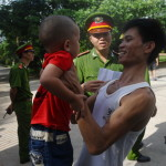 A released prisoner holds his son at the main entrance of the Hoang Tien prison in Viet Nam (Photo Credit: Hoang Dinh Nam/AFP/Getty Images).