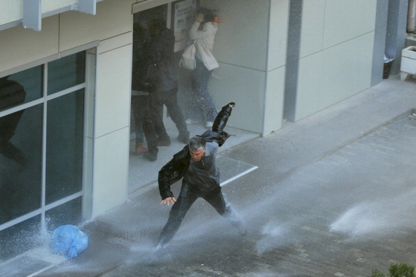 Turkish riot police use water cannon to disperse protesters outside the Supreme Electoral Council on April 1, 2014 (Photo Credit: Adam Altan/AFP/Getty Images).