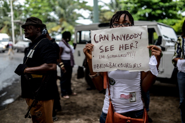 Nigerians attend a demonstration to demand government to rescue schoolgirls abducted by suspected Boko Haram militants two weeks ago (Photo Credit: Mohammed Elshamy/Anadolu Agency/Getty Images).