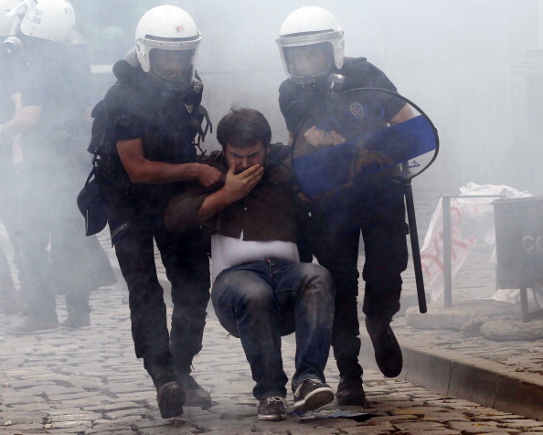 Turkish police arrest a protester during a demonstration after more than 200 people were killed in an explosion at a mine (Photo Credit: Adem Altan/AFP/Getty Images).