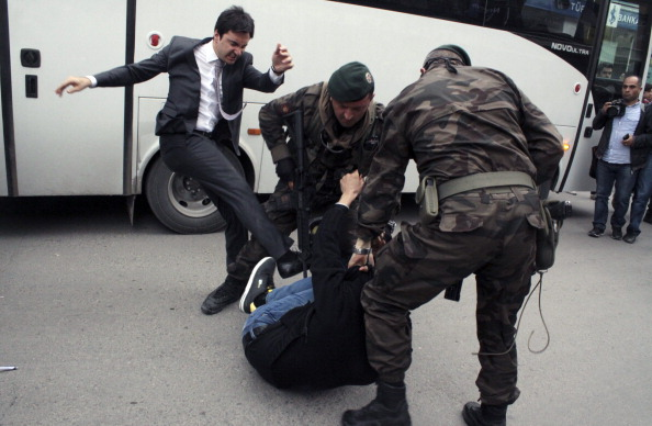 Yusuf Yerkel, advisor to Turkish Prime Minister Recep Tayyip Erdogan, kicking a protester already held by special forces police members during Erdogan's visit to Soma, Turkey (Photo Credit: Depo Photos/AFP/Getty Images).