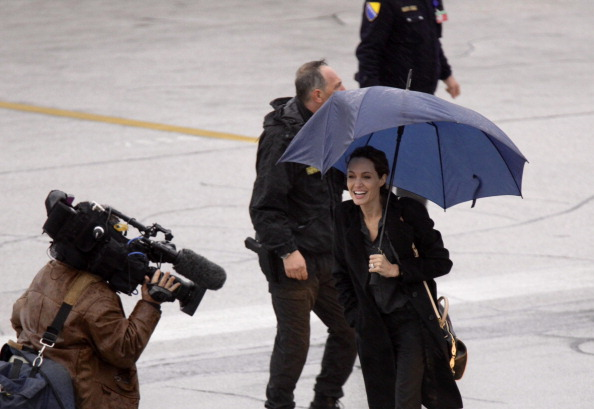 UNHCR Special Envoy Angelina Jolie arriving at the airport in Sarajevo to visit Bosnia ahead of the Global Summit to End Sexual Violence in Conflict in Bosnia and Herzegovina on March 27, 2014 (Photo Credit: Samir Yordamovic/Anadolu Agency/Getty Images).