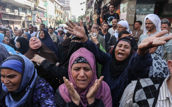 Relatives of the defendants react after an Egyptian court sentenced 638 Morsi backers to death in a mass trial in Egypt (Photo Credit: Ahmed Ismail/Anadolu Agency/Getty Images).