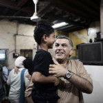Nabeel Rajab carries the son of Abdul Aziz al-Abbar, a Bahraini man who died from his wounds on February 23 after he was shot during clashes between police and protesters (Photo Credit: Mohammed Al-Shaikh/AFP/Getty Images).
