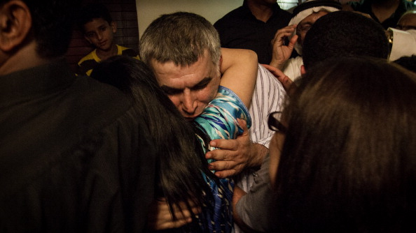 A crowd receives human rights defender Nabeel Rajab after his release from prison. (Photo credit: Hussain Albahrani/Pacific Press/LightRocket via Getty Images).