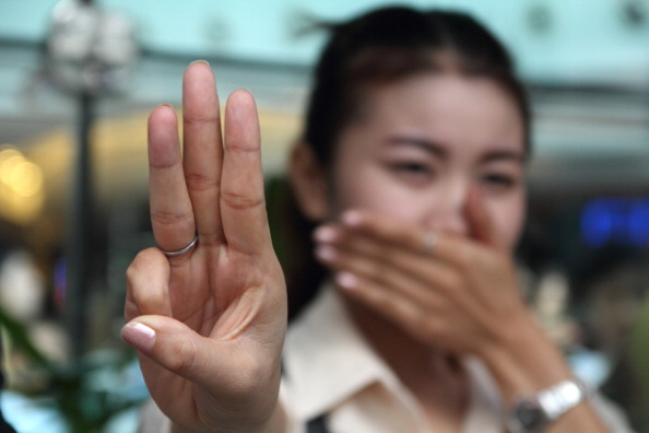 Protester raise three fingers representing liberty, brotherhood and equality during an anti-coup demonstration in Bangkok (Photo Credit: Piti A Sahakorn/LightRocket via Getty Images).