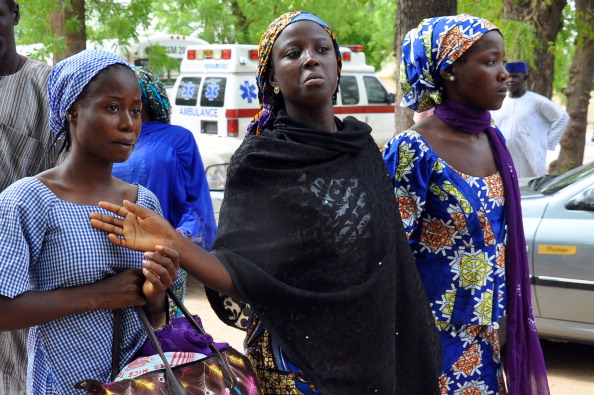 Schoolgirls who escaped from the Boko Haram arrive at the Government House to speak with the State Governor after protests supporting the kidnapped girls were banned in Nigeria's capital, Abuja (Photo Credit: STR/AFP/Getty Images).