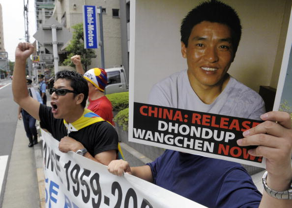 Protesters of 'Students for a Free Tibet Japan' shout slogans during a demonstration to demand the release of arrested Tibetan movie director Dhondup Wangchen in front of the Chinese embassy in Tokyo (Photo Credit: Toshifumi Kitamura/AFP/Getty Images).