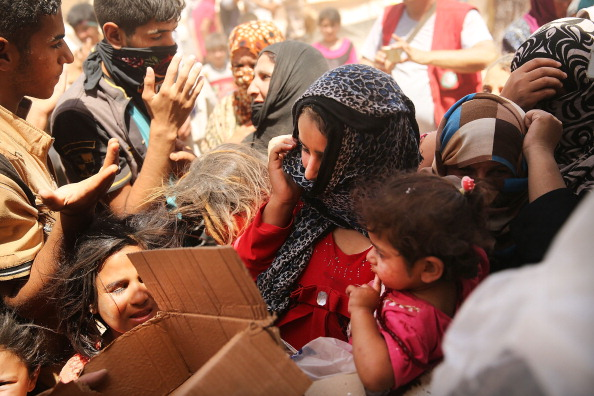 Tens of thousands of people have fled Iraq's second largest city of Mosul after it was overrun by ISIS militants. Many have been temporarily housed at various IDP camps around the region (Photo Credit: Spencer Platt/Getty Images).