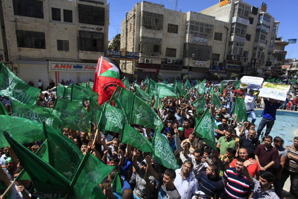 Palestinians in Ramallah gather to protest Israeli attacks on Gaza on July 25,2014 as fatalities continue to rise everyday.