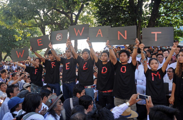 A group of protesters call for the abolition of repressive laws and an end to politically related arrests in Yangon on January 5, 2013. Thousands joined a rally in Myanmar's main city to call for the abolition of repressive laws and an end to politically related arrests. (Photo Credit: Soe Than WIN/AFP/Getty Images)