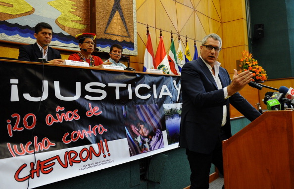 The lawyer of Ecuadorean people affected by Texaco-Chevron --who have long sought compensation for pollution between the 1970s and early 1990s-- Steven Donziger, gestures during a press conference on March 19, 2014 in Quito. (Photo credit: RODRIGO BUENDIA/AFP/Getty Images)