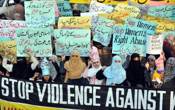 Supporters of Tehrik-e-Minhaj ul Quran, an Islamic organisation, protest against 'honor' killings of women in Lahore (Photo Credit: Arif Ali/AFP/Getty Images).