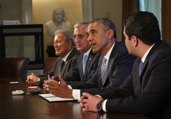 U.S. President Barack Obama speaks with President Otto Perez Molina of Guatemala, President Juan Orlando Hernandez of Honduras and President Salvador Sanchez Ceren of El Salvador about the current situation of migrant children traveling alone to the U.S. (Photo by Alex Wong/Getty Images)
