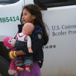 Salvadorian immigrant Stefany Marjorie, 8, holds her doll Rodrigo in Mission, Texas. Tens of thousands of immigrant families and unaccompanied minors from Central America have crossed illegally into the United States this year, causing a humanitarian crisis (Photo Credit: John Moore/Getty Images)